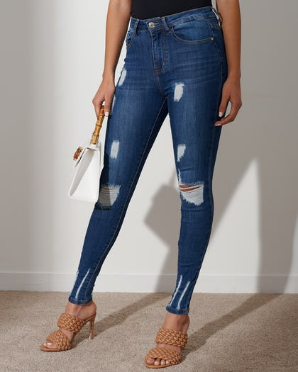 Mid-Wash Blue Distressed Skinny Jeans