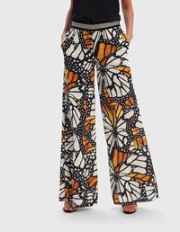 Black and Yellow Butterfly Print Trousers with Geometric Waist